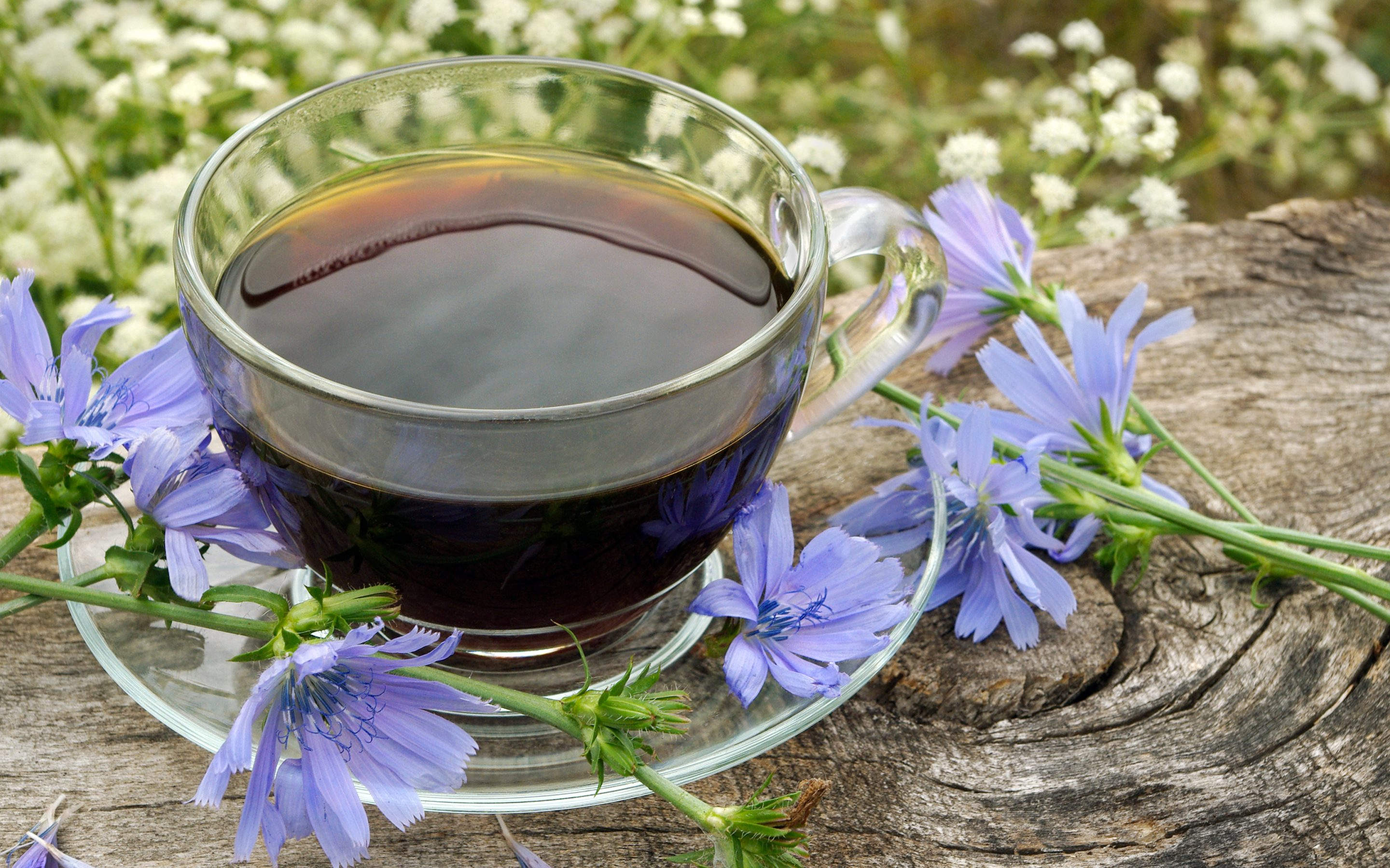 chicory coffee in glass mug with blue flowers